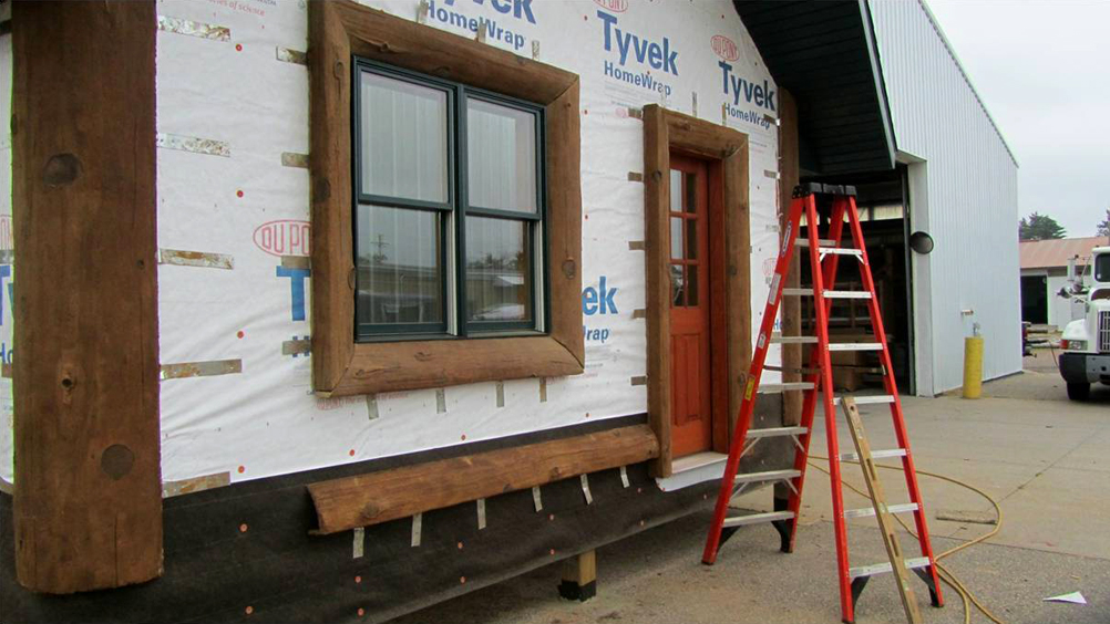 nextgen_logs_concrete_log_siding_installation_window_and_door_trim