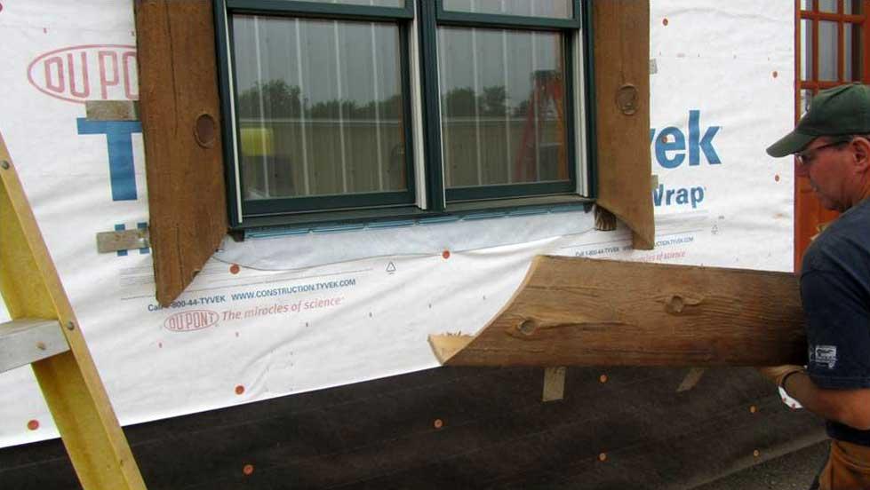 nextgen_logs_concrete_log_siding_installation_window_trim