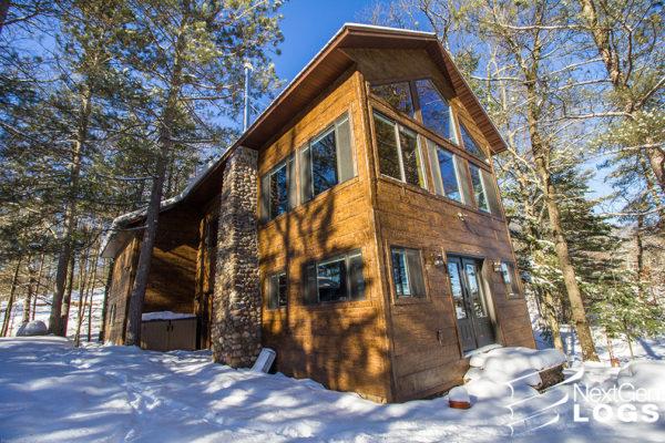 nextgen_logs_concrete_log_siding_hand_hewn_siding_hayward_lake_home_004