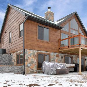 nextgen_logs_concrete_log_siding_hand_hewn_timber_siding_castle_rock_lake_home_006